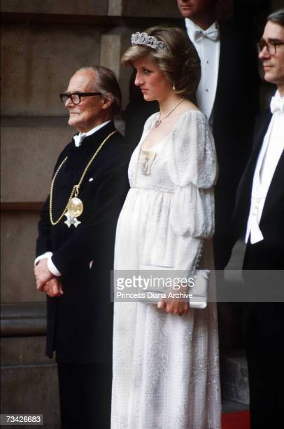 A pregnant Princess Diana with architect and writer Sir Hugh Casson at the Royal Academy of Arts London May 1984 The princess is wearing an 'empire...