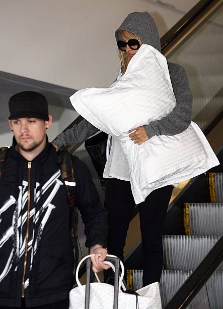 Pregnant Television Personality Nicole Richie Leaves Perth Airport With Partner Joel Madden Of Good Charlotte Following