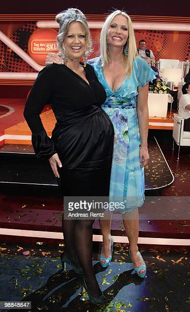 Pregnant TV host Barbara Schoeneberger and Sonya Kraus pose during the SKL show 'Tag des Gluecks' at Tempodrom on May 4, 2010 in Berlin, Germany.