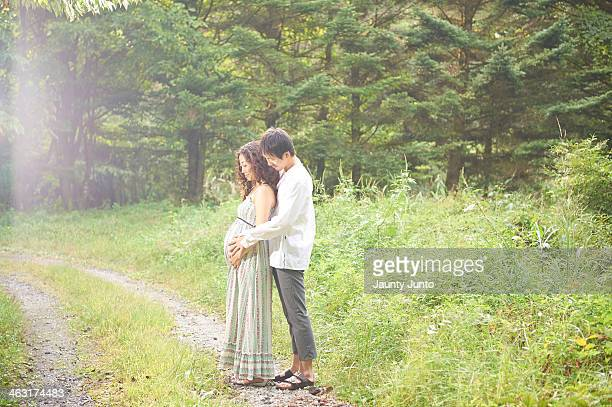 pregnant wife and her husband, portrait
