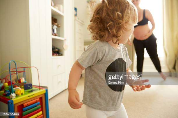 pregnant woman and daughter in bedroom - runaway stock pictures, royalty-free photos & images