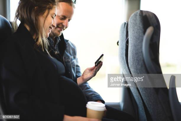 pregnant woman and her boyfriend traveling by bus - pregnant coffee stock pictures, royalty-free photos & images