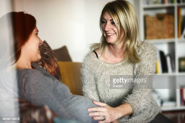 Pregnant woman and her mother discussing about prenatal care
