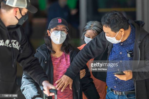A pregnant woman arrives to LAX Tom Bradley International Terminal wearing a medical mask for protection against the coronavirus outbreak on February...