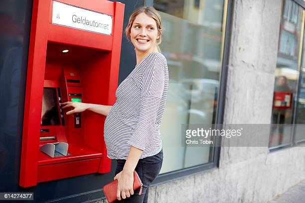 Pregnant woman at ATM