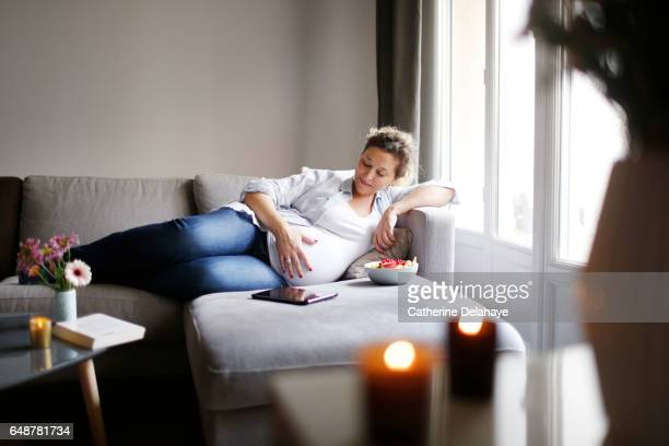 a pregnant woman at home - une seule femme stock pictures, royalty-free photos & images