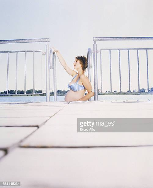 Pregnant woman at outdoor swimming pool