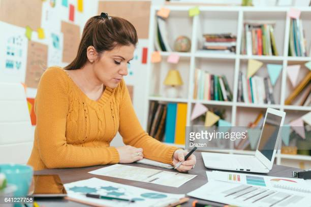 Pregnant woman at work, dealing with tasks in new office