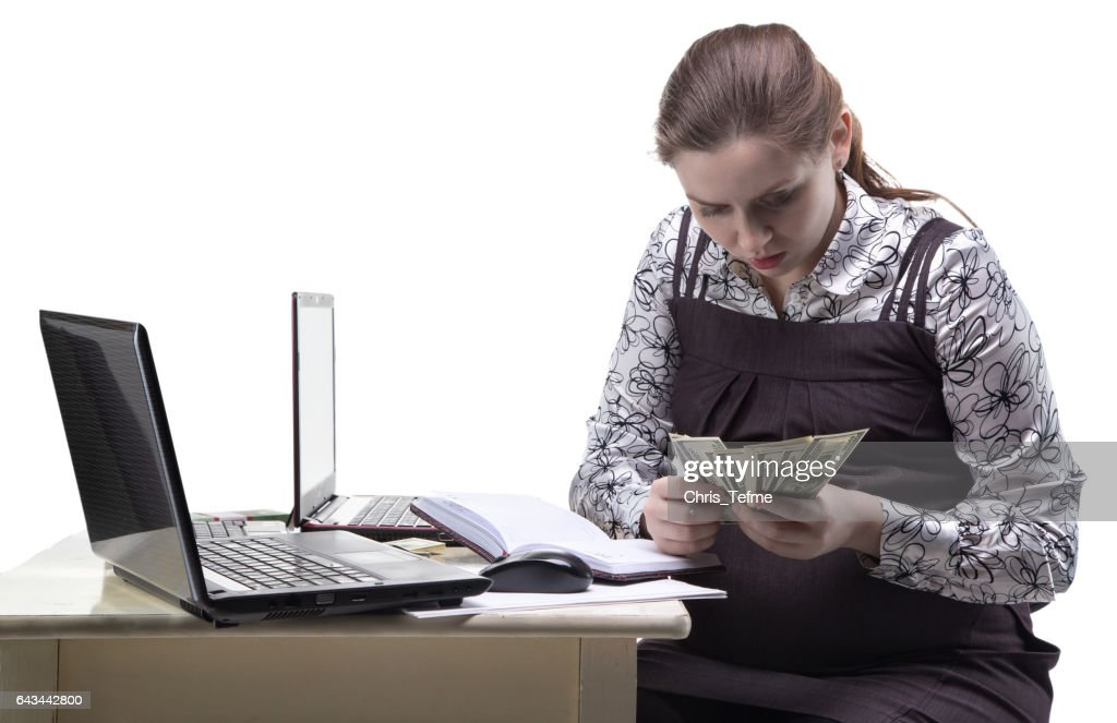 Pregnant woman counting money : Stock Photo