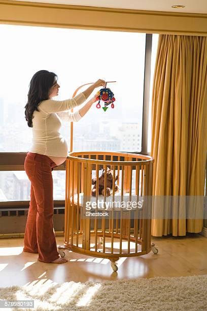 Pregnant woman decorating nursery