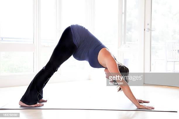 Pregnant Woman Doing Downward-Facing Dog Yoga Pose