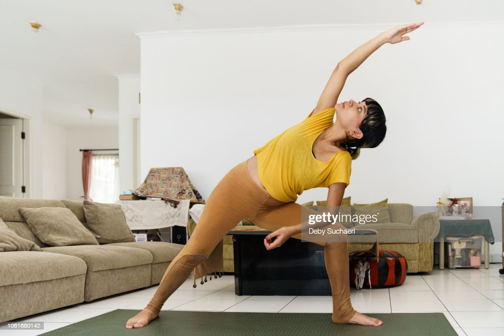 Pregnant woman doing stretching and yoga : Stock-Foto