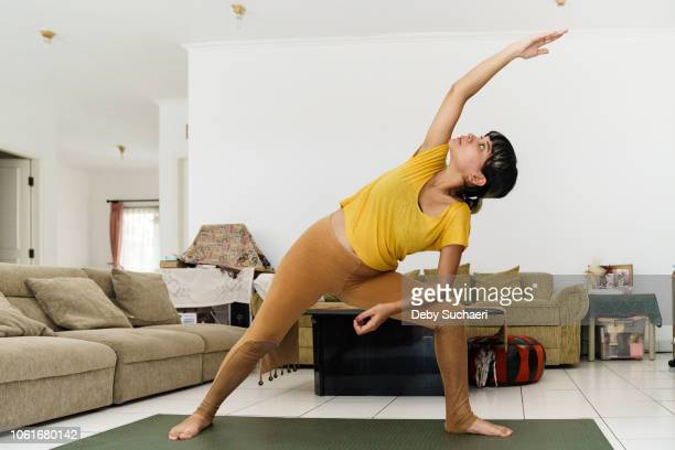 Pregnant woman doing stretching and yoga