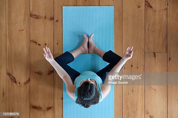 pregnant woman doing yoga - mat stock pictures, royalty-free photos & images