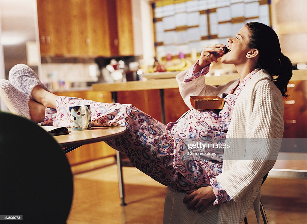 Pregnant Woman Eating Chocolate : Stock Photo