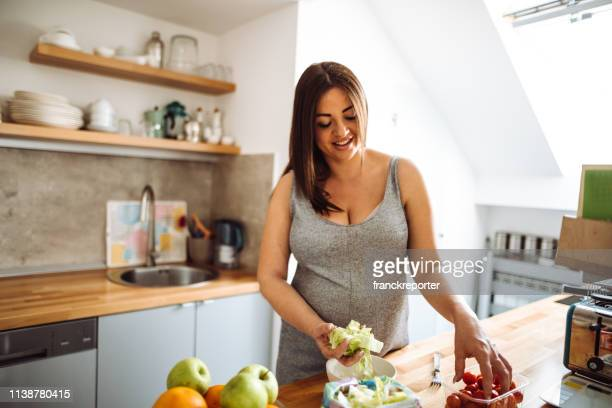 pregnant woman eating healthy food at home - fat nutrient stock pictures, royalty-free photos & images
