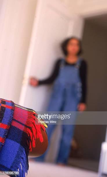 Pregnant woman entering room