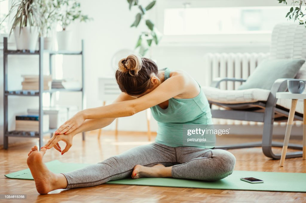 Pregnant woman exercise : Stock Photo