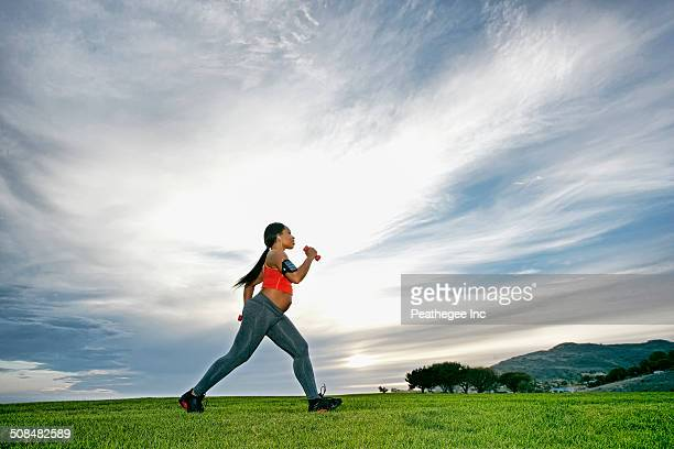 Pregnant woman exercising in park