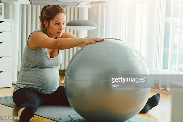 Pregnant Woman Exercising Pilates.