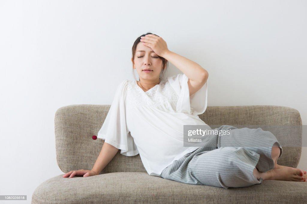 Pregnant woman Falls : Stock Photo