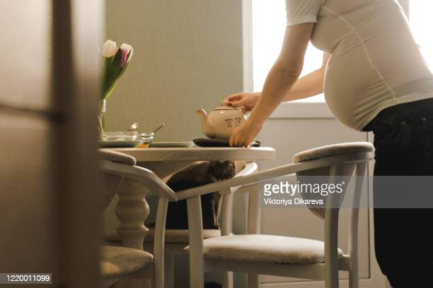 pregnant woman having breakfast. - pregnant coffee stock pictures, royalty-free photos & images