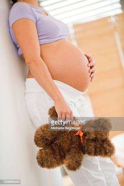 Pregnant woman holding a teddybear