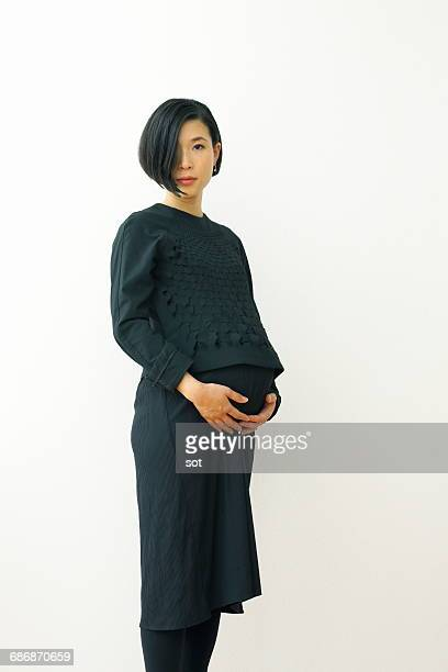 Pregnant woman holding belly