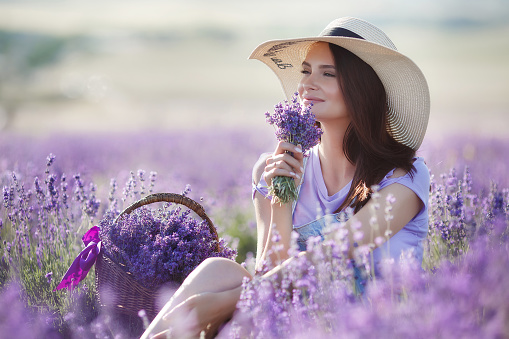 Pregnant woman in lavender field on summer day 1035463522