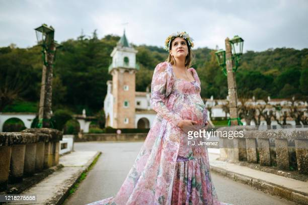 pregnant woman in wedding dress - maternity wear stock pictures, royalty-free photos & images