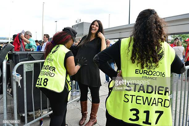 A pregnant woman is checked by security at the entrance to the stadium before the GroupA preliminary round match between France and Romania at Stade...