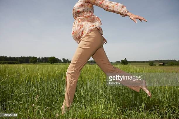 pregnant woman jumping through corn field - low section stock pictures, royalty-free photos & images