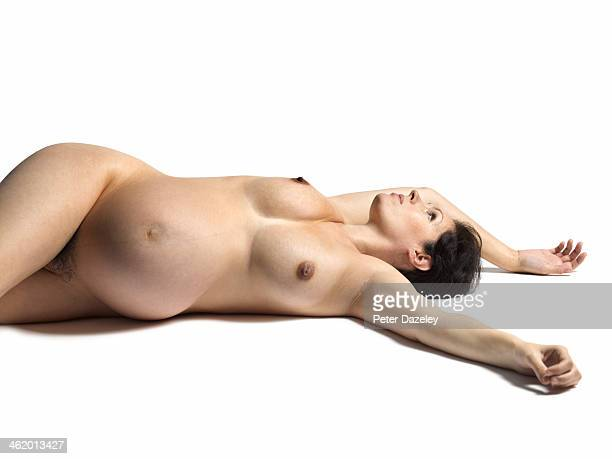 Pregnant woman lying on floor