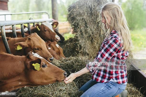 Pregnant woman on farm