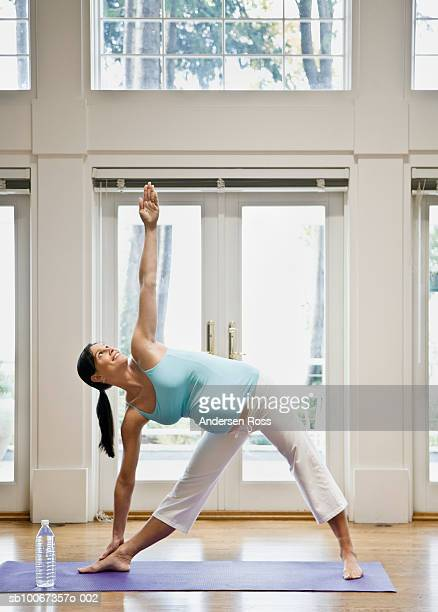 Pregnant woman practicing yoga, arms out