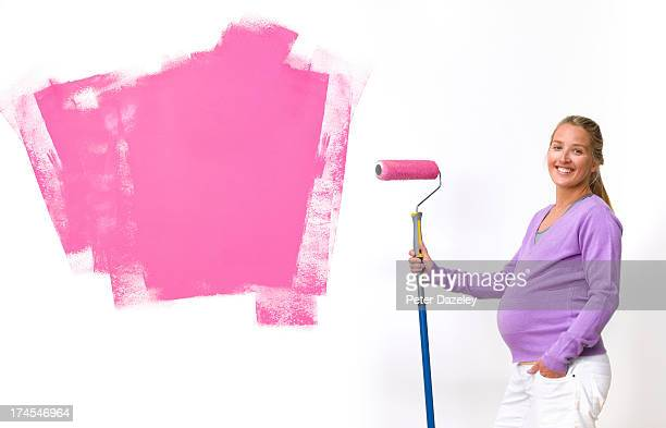 Pregnant woman preparing nursery