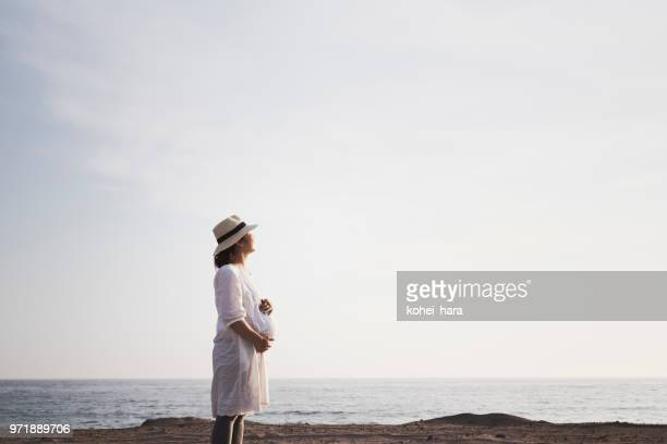 Pregnant woman relaxed at seaside