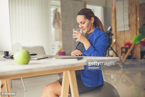Pregnant woman relaxing at office