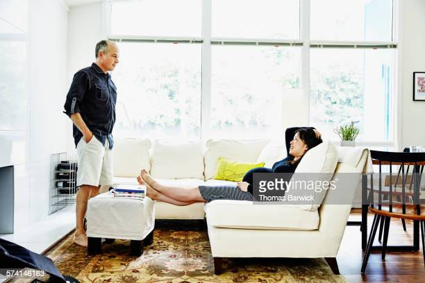 Pregnant woman relaxing in in living room