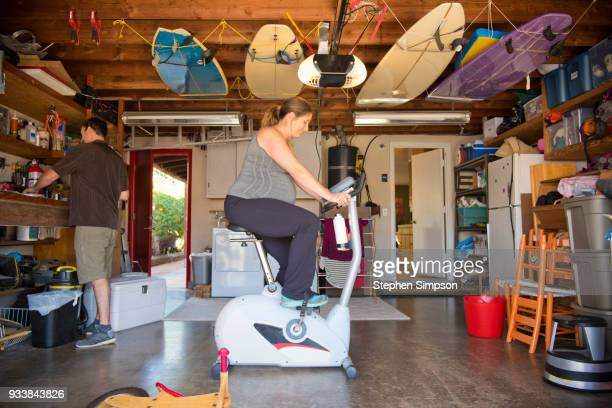Pregnant woman rides stationary bike