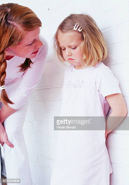 pregnant woman scolding her daughter