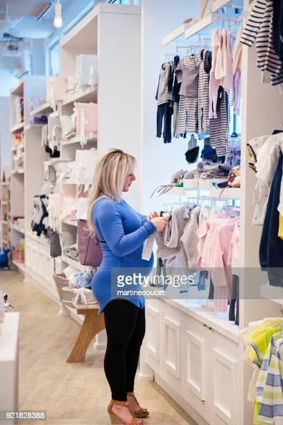 Pregnant woman shopping in a children store.