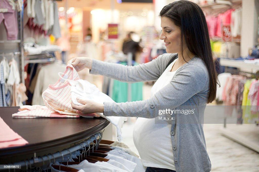 Pregnant woman shopping : Stock Photo