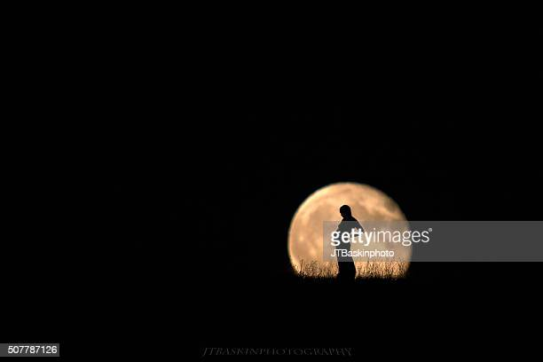 Pregnant Woman Silhouetted in the Rising Moon