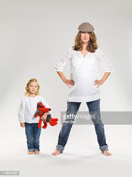 Pregnant woman standing with daughter