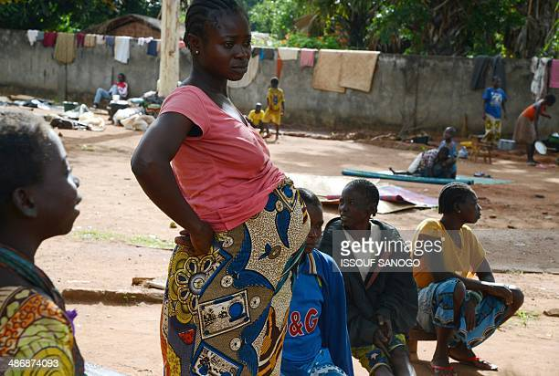 A pregnant woman stands in the courtyard of a Catholic church where residents took refuge after an exSeleka rebels' incursion in Bouca on April 26...