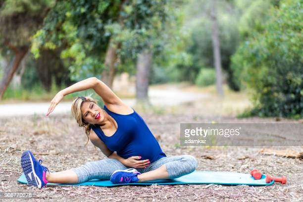 Pregnant Woman Stretching doing Yoga
