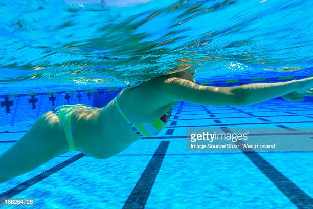Pregnant woman swimming in pool