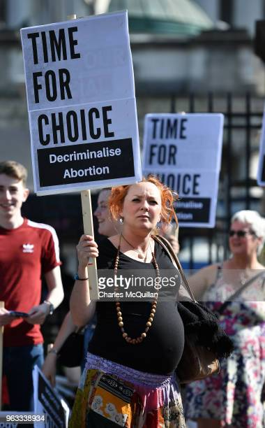 A pregnant woman takes part in the campaign group Solidarity with Repeal as it holds a rally calling for abortion rights outside Belfast City Hall on...