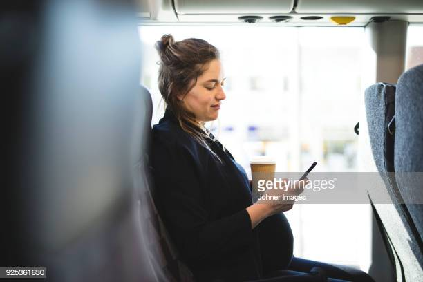pregnant woman traveling by bus - pregnant coffee stock pictures, royalty-free photos & images
